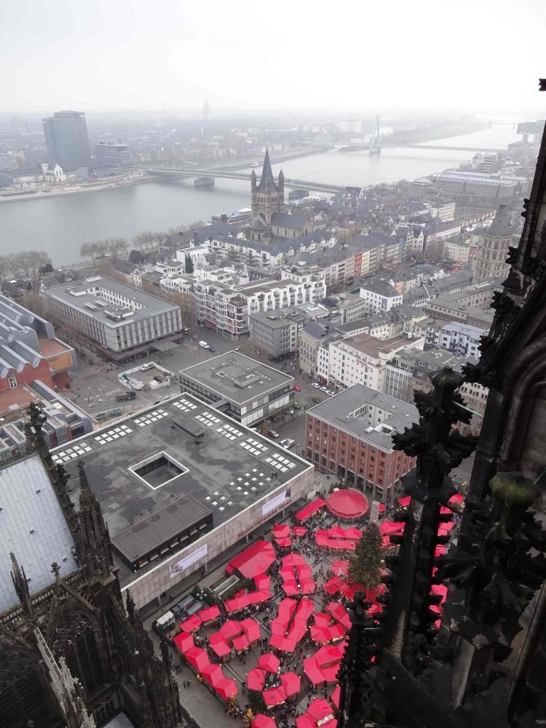 There is a (safety-caged) viewing platform at the top of the tower over 90 metres above the red roofs of the Weihnachtsmarkt am Kölner Dom (Cathedral Christmas Market) stalls below