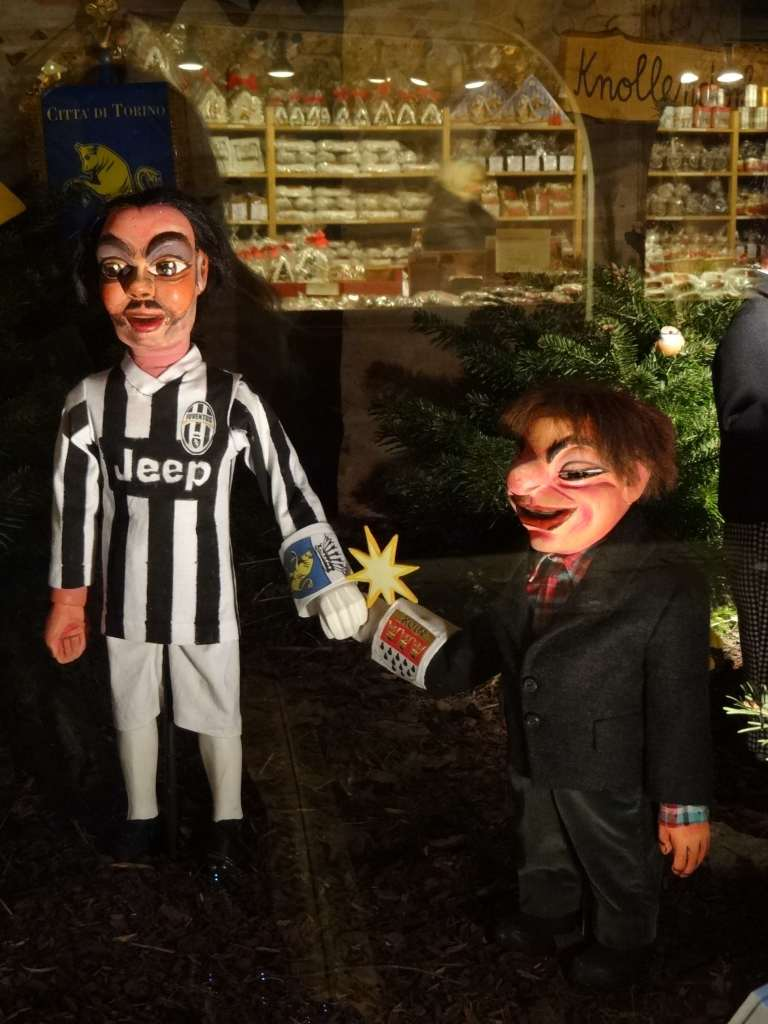 Two rather odd looking figures by the crib representing the annual twinning of Cologne with the Italian city of Turin during the festive period, a Christmas tradition between the cities since 1958