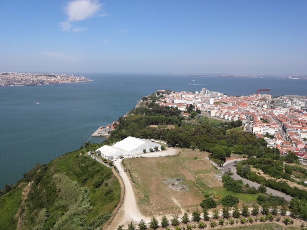Cacilhas seen at the tip of the Almada peninsula, with Lisbon city across the bay (left)