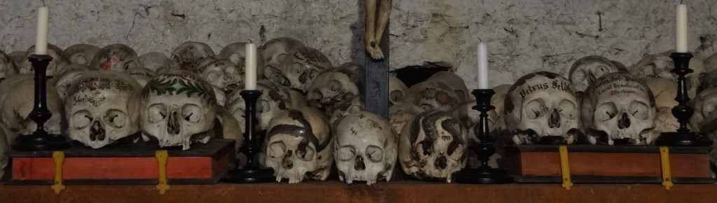 The skulls sitting on the bibles either side of the Cross are those of local priests