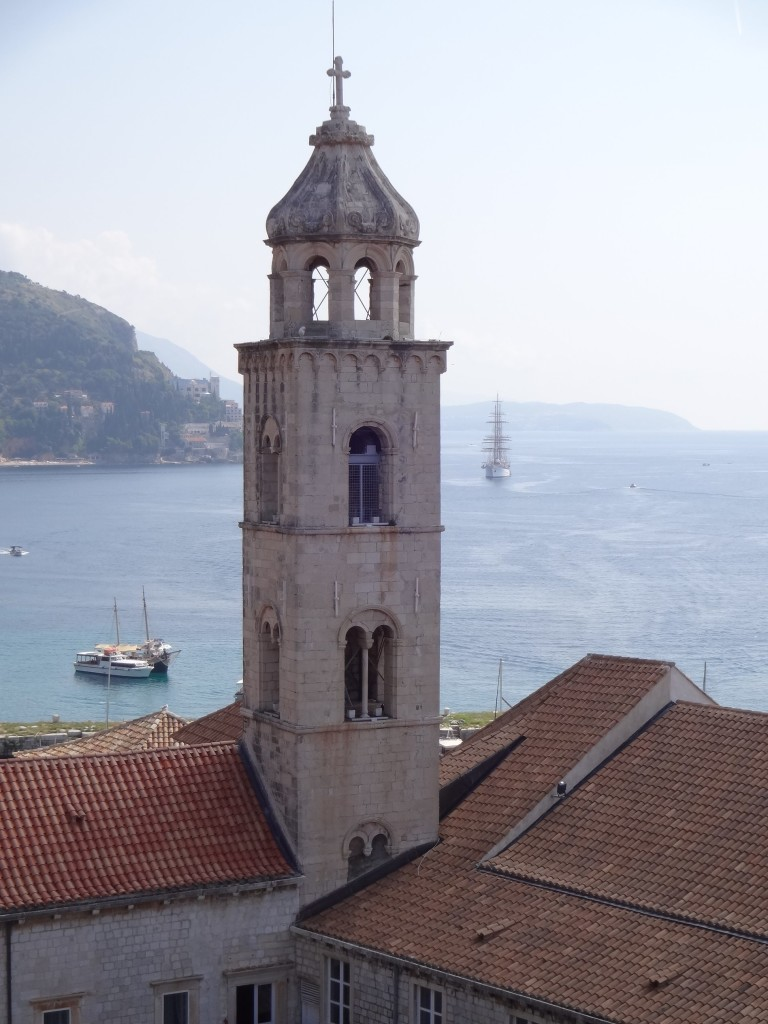 Dubrovnik Old City Walls Dominican Monastery-museum Dominikanski samostan-muzej bell tower close up with bay and ship