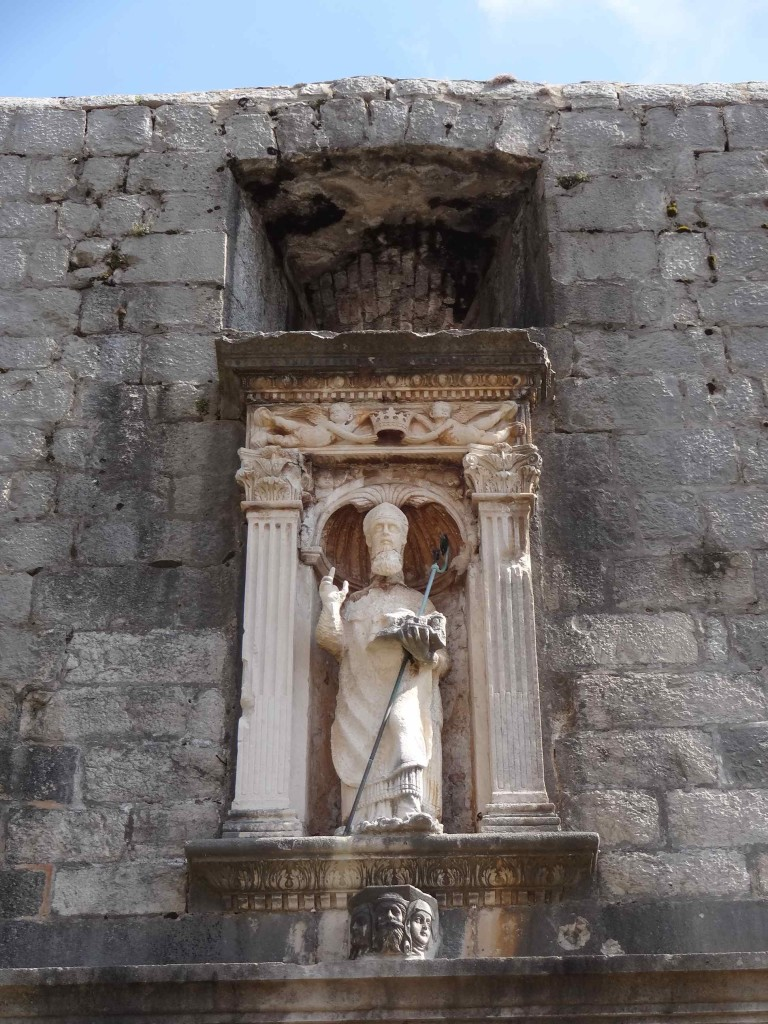Over the draw-bridge of Pile Gate is the first of many statues dedicated to Saint Blaise, Dubrovnik's patron saint and protector. The slashes across his throat and beard could be symbolic of his martyrdom (he was beheaded) ... or they could just simply be weaknesses in the marble