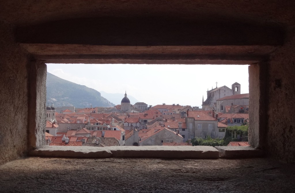 Dubrovnik Old City Walls view over city through gap in the wall