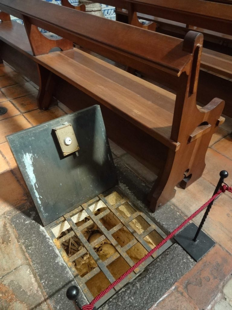 The trap door to the ossuary inside the Church of Saint John the Evangelist