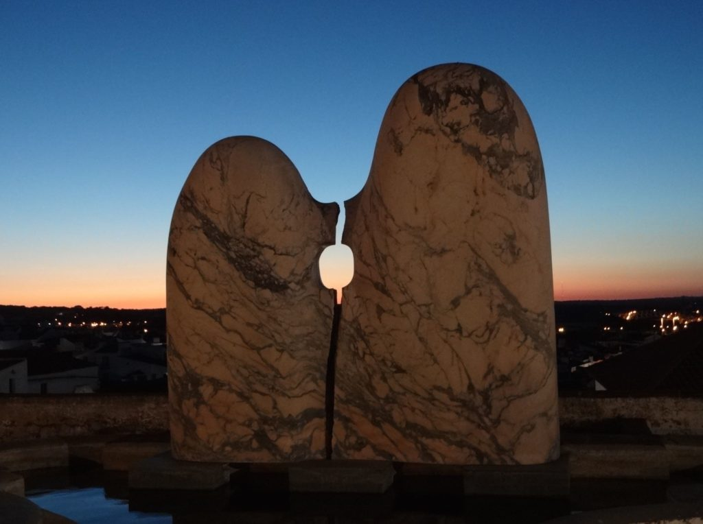 The Kissing Stones. The panoramic views of Évora behind this sculpture are stunning. The general view of this sculpture is that no one seems to know what exactly it is supposed to be or represent