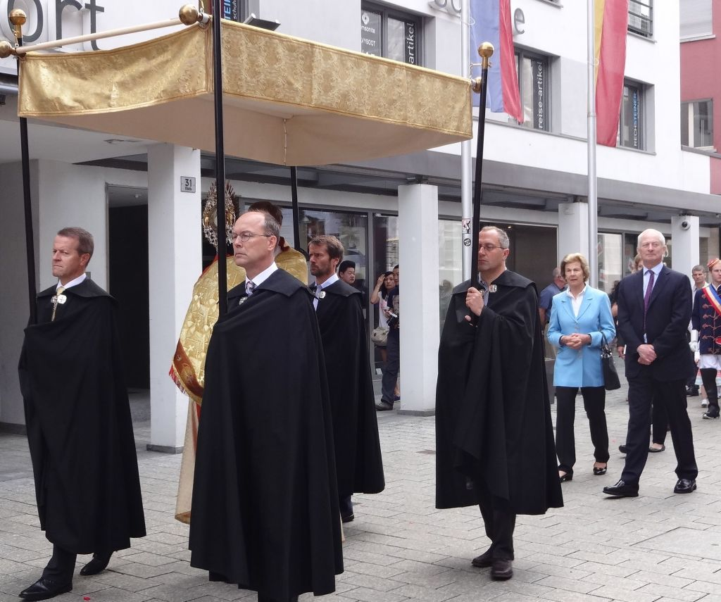 Their Serene Highnesses the Prince and Princess of Liechtenstein leading the procession through Vaduz along Städtle