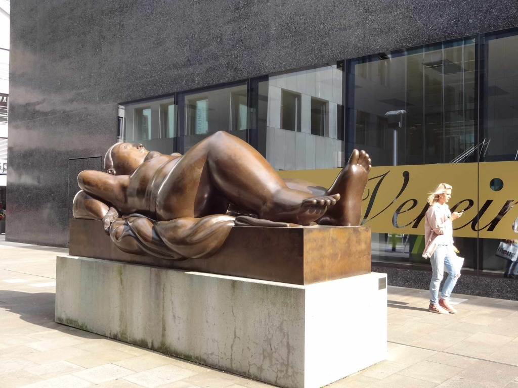 There seems to be more sculptures of people in Vaduz than actual people. 'Ruhende Frau' (Reclining Woman') by Fernando Botero next to the country's National Art Museum and... is that a real, live woman walking past it?