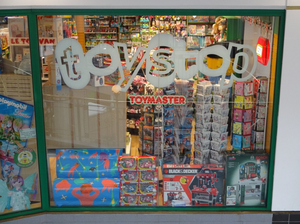 The curious incident of a mini bookbench in the window of the Toy Stop toy shop (bottom left)