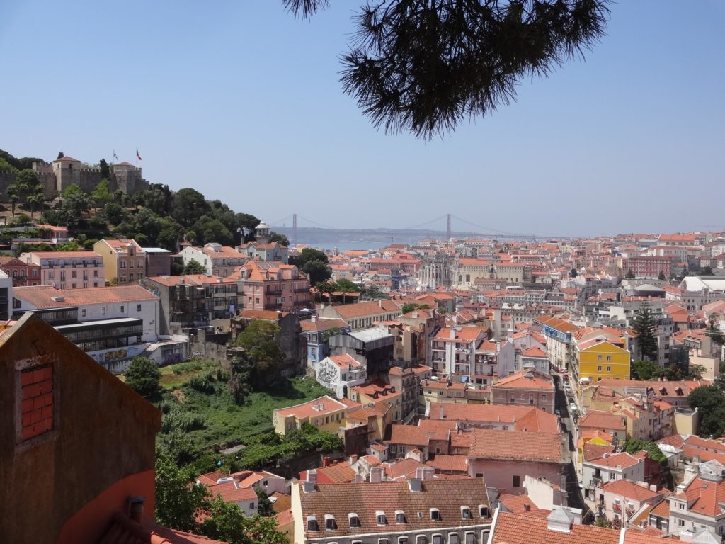 The stunning panorama enjoyed from Miradouro da Graca, one of several key viewing points in Lisbon looking out across the handsome rooftops of the city. In the distance one can see what looks like San Francisco's Golden Gate bridge