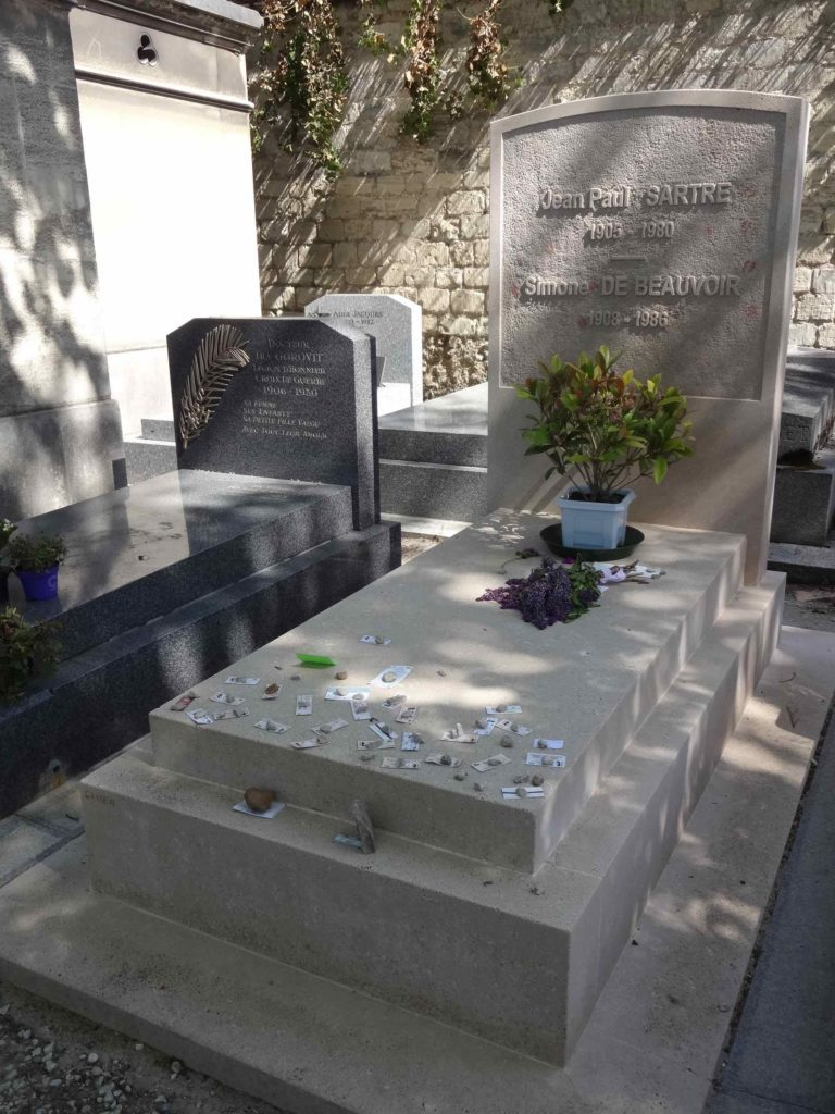 It is not so easy to explain why Jean Paul Sartre and Simone de Beauvoir's grave stone is also covered in metro tickets in the cemetery