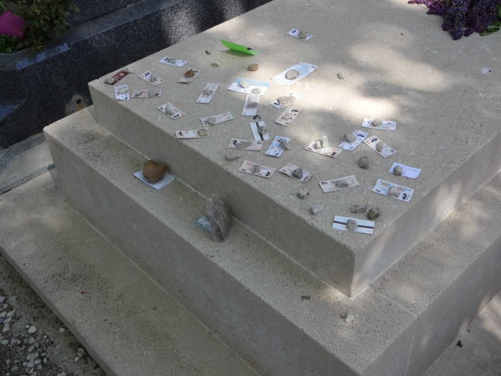 A symbol of Communist struggle or a complete misunderstanding of tradition? Why do people specifically leave metro tickets on Jean Paul Sartre's grave?