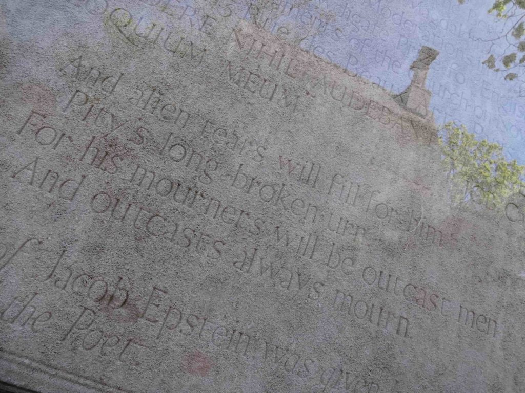 A piece from Wilde's Ballad of Reading Gaol, inscribed on the back of the head stone