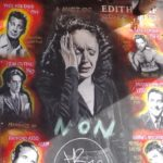 An emotional portrait of Ms Piaf hangs in its window looking down at La Foule