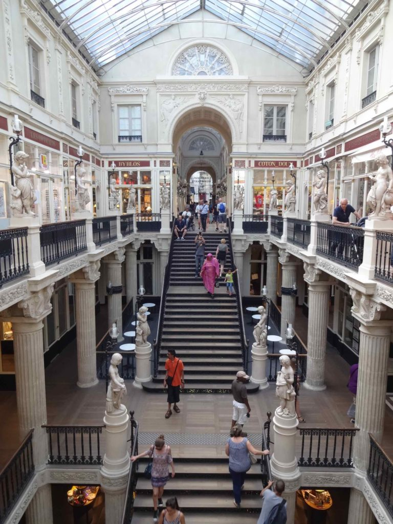 Louis Pommeraye faced a climb of nearly ten metres between the two areas he wished his passageway to link. His tiered stairway design and multi-floor shopping area was innovative for its time