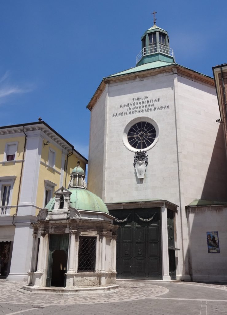 The Temple of the Sacred Eucharist with the Little Temple to Saint Antony of Padua in front of it marking the spot where a mule converted a non-believer to Christianity