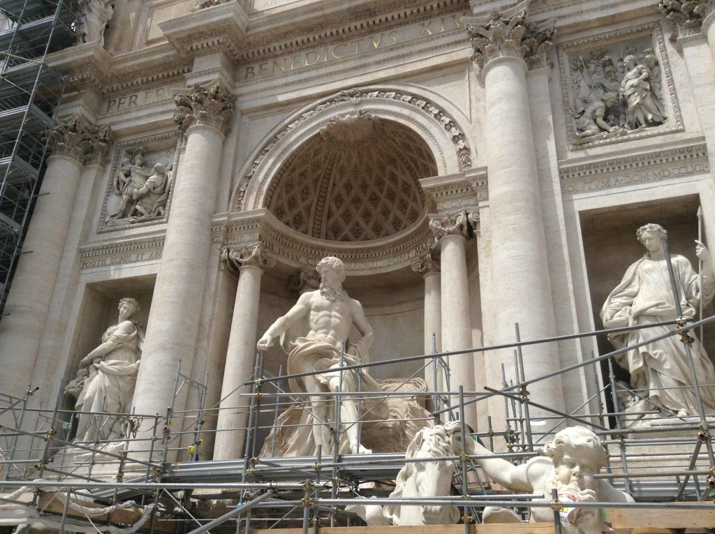 Walking across where the water used to be to see the Trevi façade closer than ever before