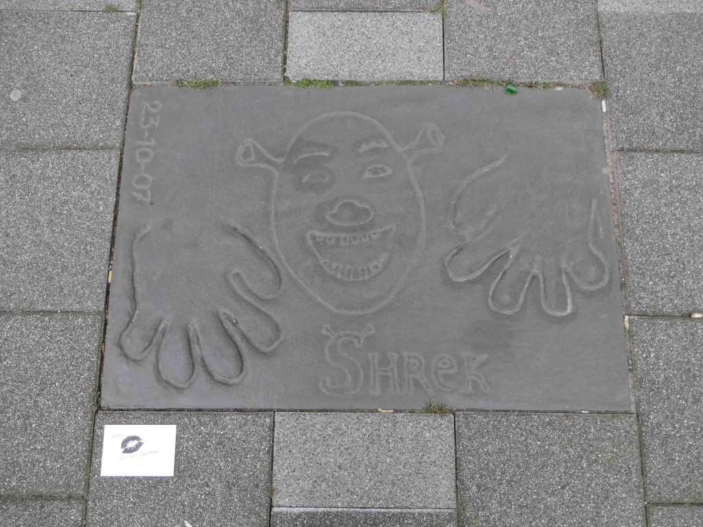 ... and ...er ... Shrek? (Did he really put his face into the cement as well as his hands?)