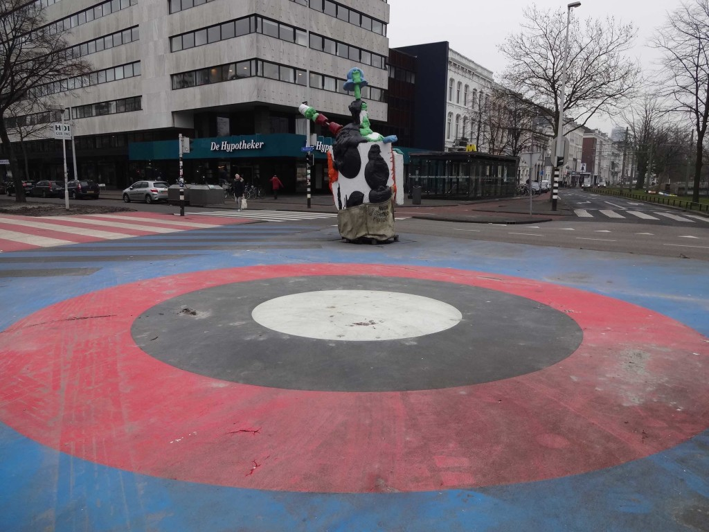 Anita by David Bade (2001), close to Eendrachtsplein metro station. The target part of the piece is in the middle of the road leading some motorists to mistake it for a roundabout