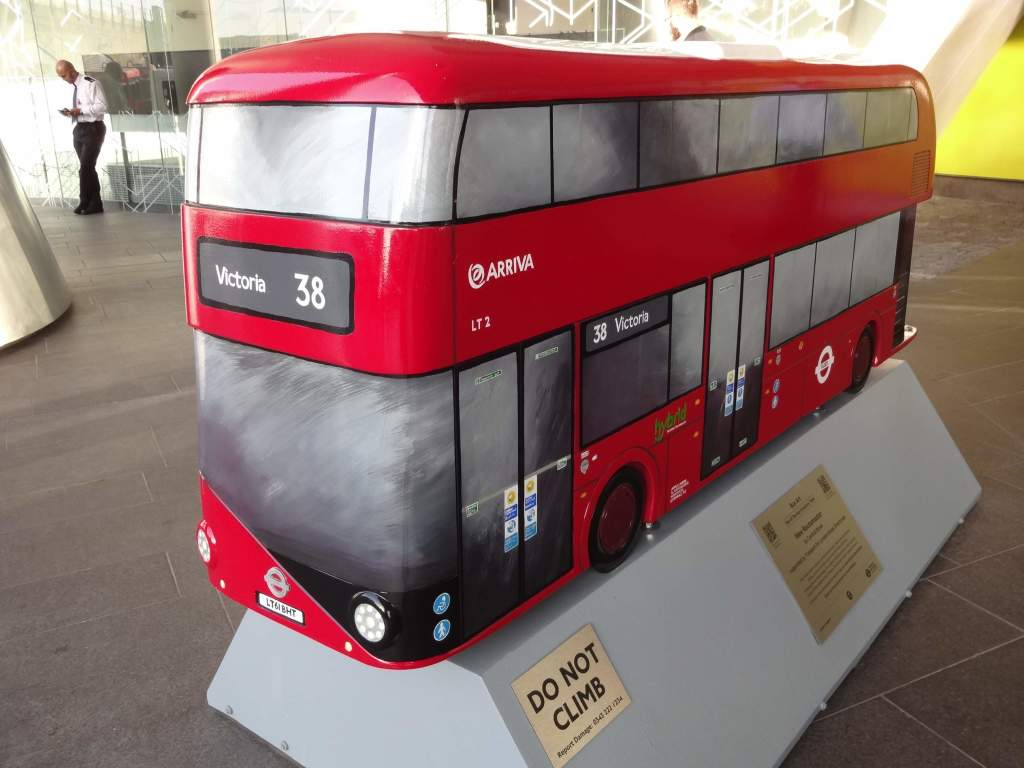 The man in the background is at a distance and not a scaled down model of a bus driver to go with this perfect mini Routemaster
