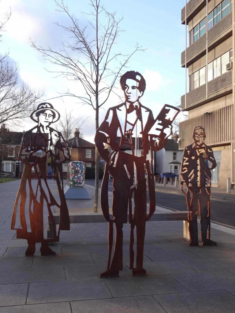 Figures of Croydon born Dame Peggy Ashcroft, and famous Croydon residents Samuel Coleridge-Taylor and comedian Ronnie Corbett. Maybe Kate Moss's figure (arguably the most famous person to come out of Croydon) is hiding behind Alice Cretney's bus sculpture