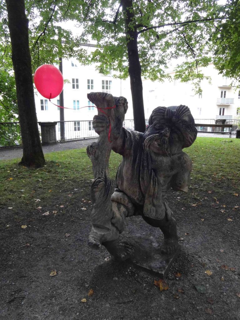 Salzburg, Do-Re-Mi gnomes at Mirabellgarten, moustache and balloon