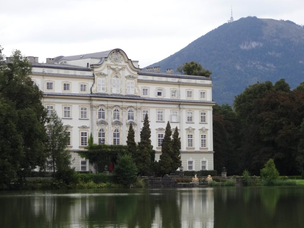 Schloss Leopoldskron is a 3-star hotel with Fort Knox style security. Unless booked to stay the night here, no one can get past the security guards at the door to take a quick photo on the lakeside terrace where a sodden Maria and the children first meet the Baroness