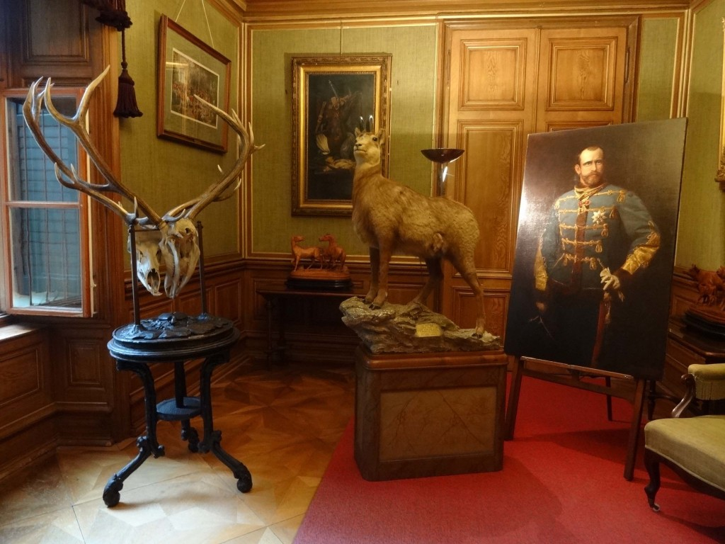 In the aptly named Hunting Room are the remains of the 2000th chamois shot by the Emperor (centre, next to a portrait of the Emperor's son, Crown Prince Rudolf) and the skulls of two stags whose anklers became tangled during a duel
