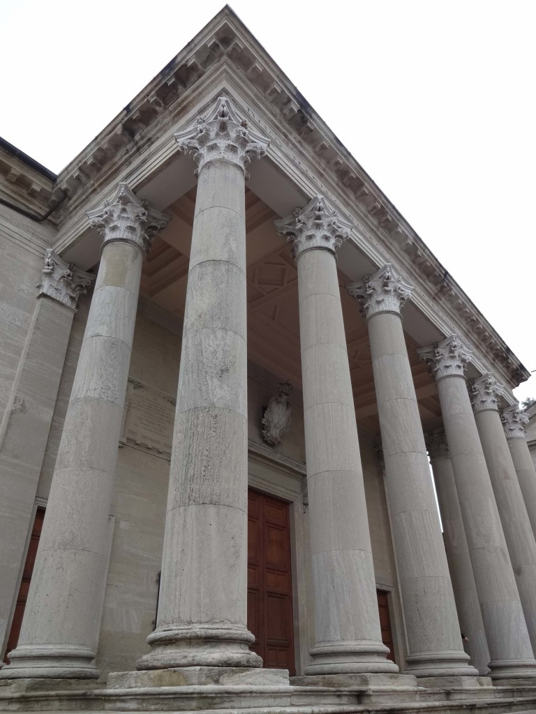 The Basilica is awash with columns, both on the outside...