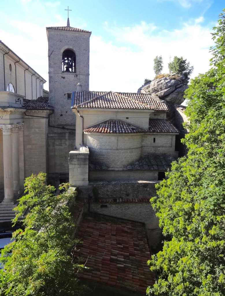 From the neighbouring Borghesi Gardens one can appreciate the original architecture of the little church built into the rock. Less appreciation may be had for the replica roof tiles