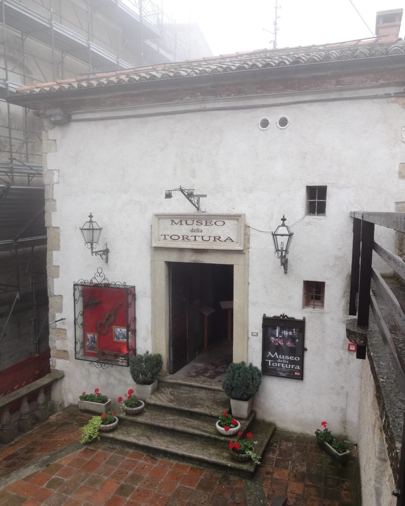 The surprisingly quaint entrance to San Marino's Museum of Torture. The mist was real and not a special effect used to create an eerie atmosphere about the place