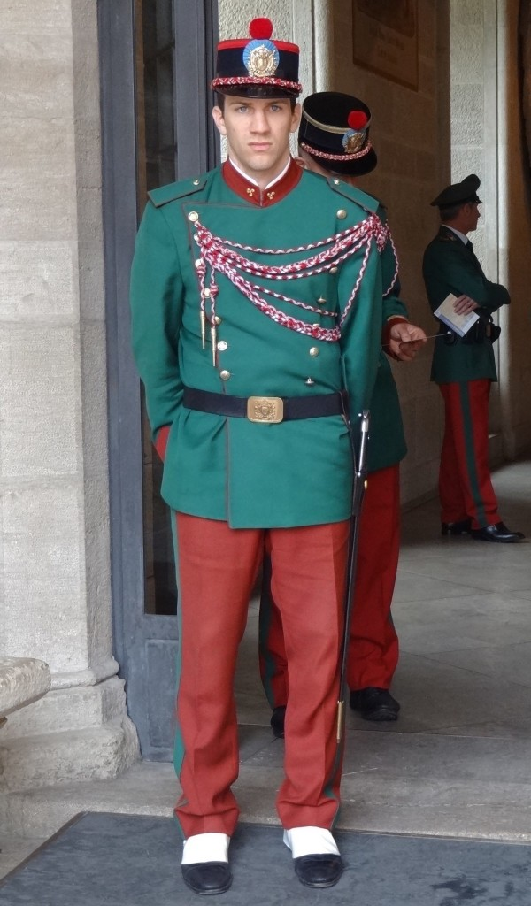 The art of pom pom balancing. Don't be fooled by the Christmas elf coloured uniform. The Guardia di Rocca will defend to the death if need be...
