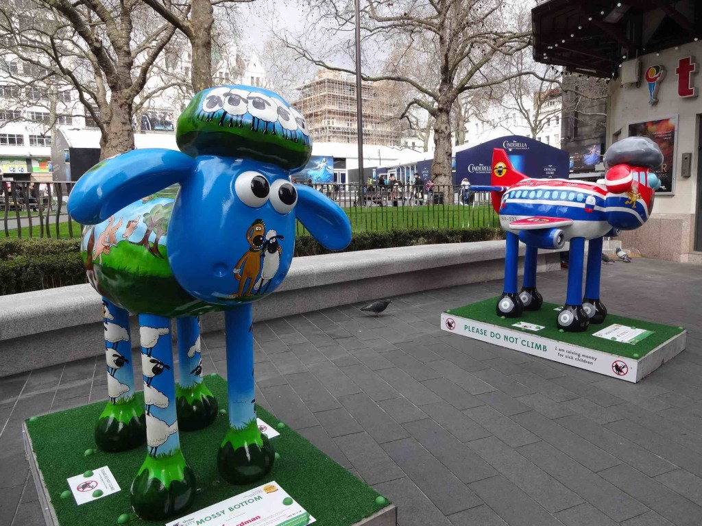 Shaun in the City London Shaun's Trail, Mossy Bottom Shaun, Leicester Square Gardens, Sylvia Bull, Aardman, and Shaun in the City London Shaun's Trail, Woolly Jumbo, Leicester Square Gardens, Joseph Dunmore, China Eastern Airlines