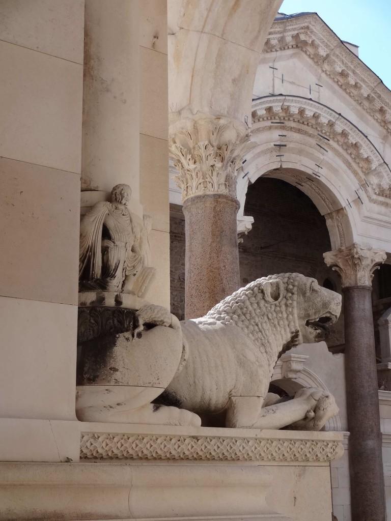 One of two fifteenth century stone lions carrying figures of Adam (shown) and Eve, guarding the entrance to the belfry and the adjoining Cathedral of St Dominus