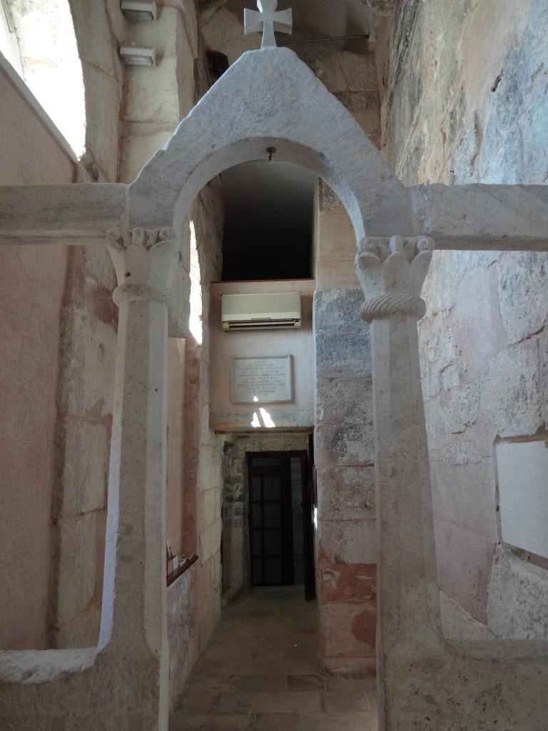 Looking towards the entrance to the Medieval church and the not-so Medieval air conditioning system over the doorway