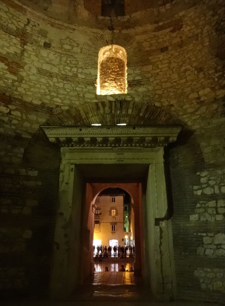 Inside Diocletian's vestibule respectfully lit by night, looking out towards the Peristil
