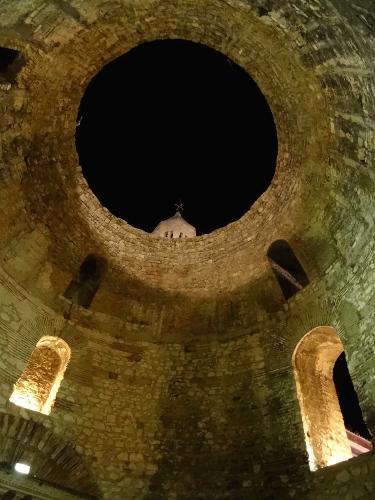 The top of the belfry peeking over the oculus of the vestibule's domed roof