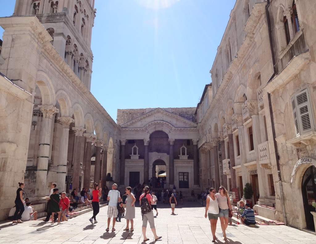 The Peristil: what is left of the two-thousand-year-old Roman courtyard by the entrance into Diocletian's Palace living quarters ahead, and the colossal belfry beside the colonnade to the left