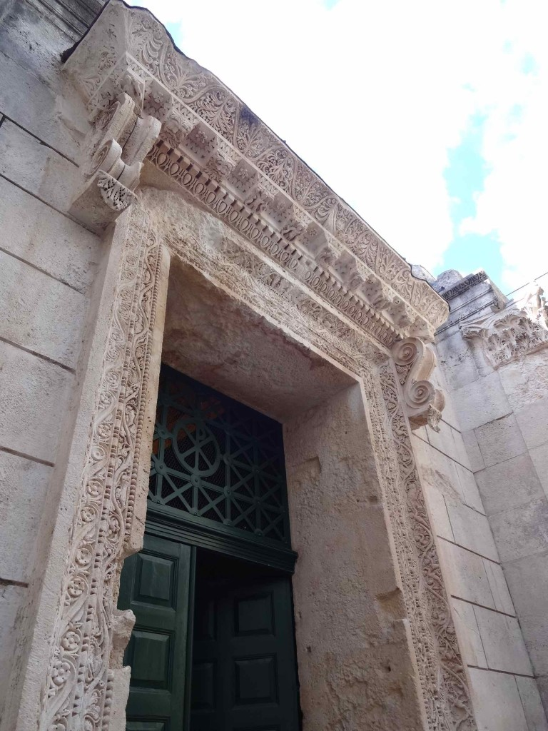 It is strange that on converting the Temple of Jupiter into a Christian baptistery, the Christians chose to keep the polytheistic Roman detail around the doorway. It clearly suggests there is more than one God, unlike the ceremonies that later took place inside