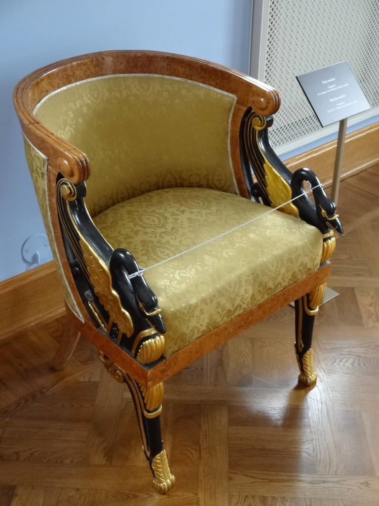 A rather delightful early nineteenth century Russian Master Armchair. I particularly like the black swan armrests