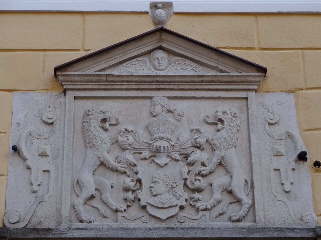 The Brotherhood of the Blackheads' crest over the door with a likeness of their patron saint Saint Maurice featured on the shield between the lions