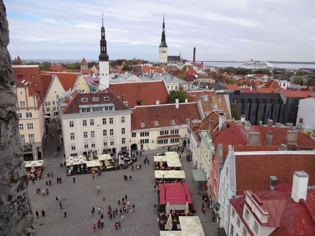 Raekoja plats (Old Town square) below, St Olaf's church and the Baltic sea