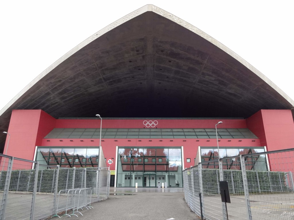 The entrance to the Palavela wearing its 2006 Winter Olympic rings with pride. There doesn't seem to be much supporting the rather thin looking concrete roof. No wonder some of the Italian Job film crew at the time were concerned whether the stunt would be a success