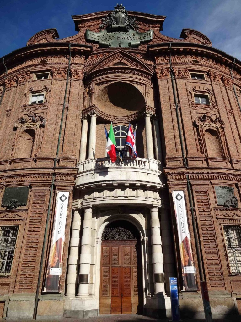 The baroque Palazzo Carignano on Via Accademia delle Scienze, once a royal private residence, now home to the National Museum of the Italian Risorgimento. It was also here that The Italian Job heist began with the bullion van being sieged and taken into the building by Croker and his gang