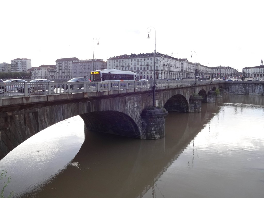 A symbol of triumph: the Napoleonic Vittorio Emanuele I bridge (seen here from the east bank of the River Po) where everyone is invited to walk (or drive) across it at some point during their stay in Turin. French tourists now welcome