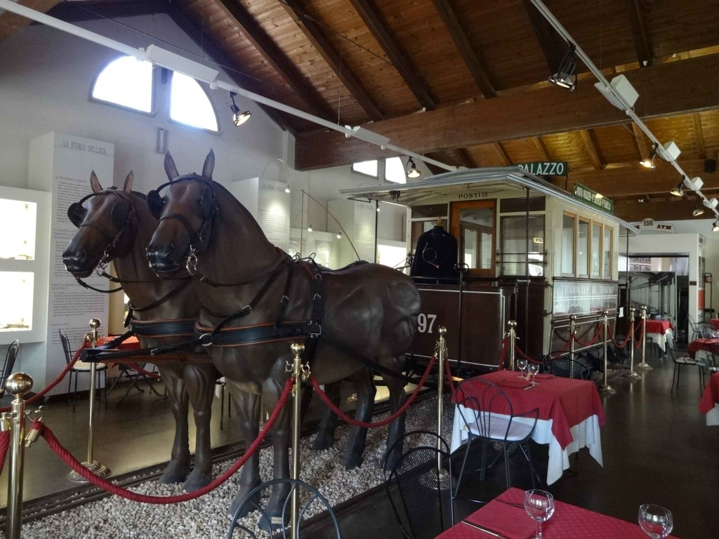 Celebrating the station's history in the restaurant with memorabilia adorning the walls and one of the original horse-drawn carriages between tables