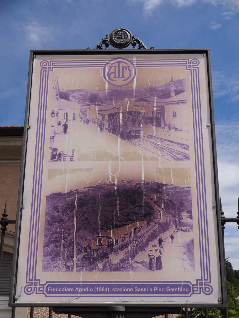 Sun-bleached photos of the original funicular on display outside Sassi station