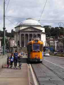 A thing of beauty. One of Turin's many delightful old style trams with the Gran Madre di Dio in the background (contented sigh)