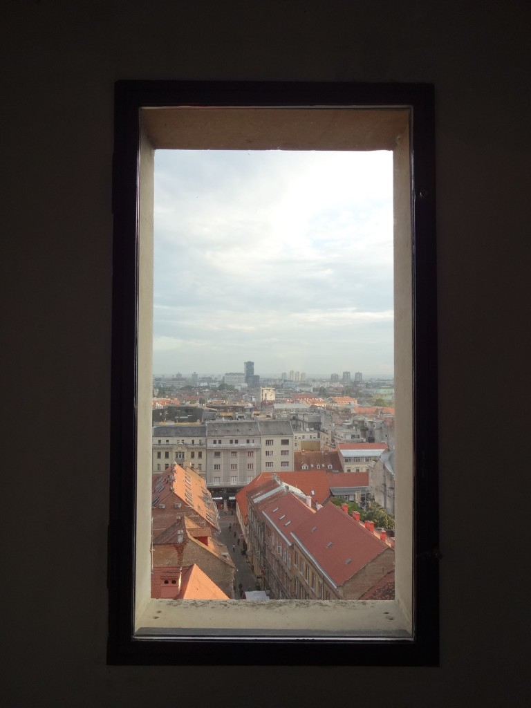Looking south towards the Lower Town of Zagreb through one of the windows of Lotrščak Tower