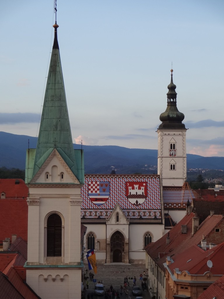 The emblematic roof of St Mark's Church, Zagreb (behind the green spire of a neighbouring church)