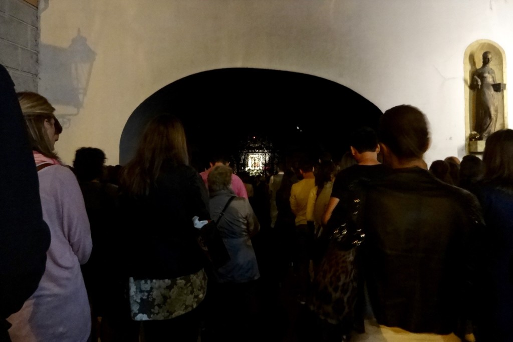 Standing room only: the daily saying of the rosary to the illuminated painting of the Virgin Mary (Kamenita ulica entrance)